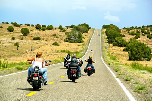 Waving_from_motorcycle_on_open_road